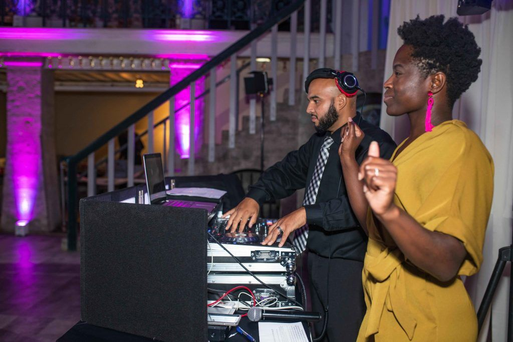 DJ playing with guest dancing