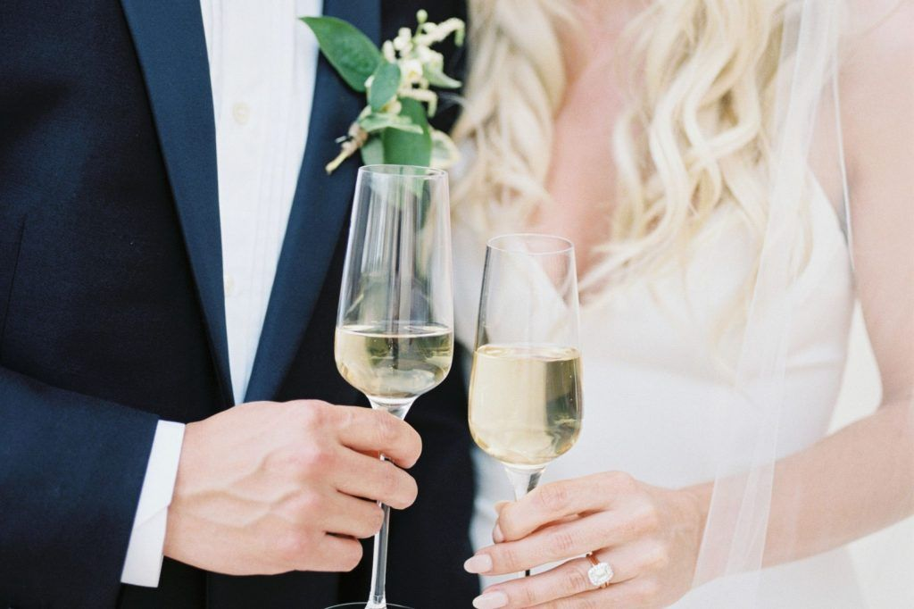 bride and groom holding champagne