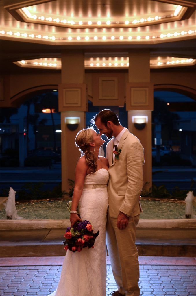 bride and groom in front of daytona hilton