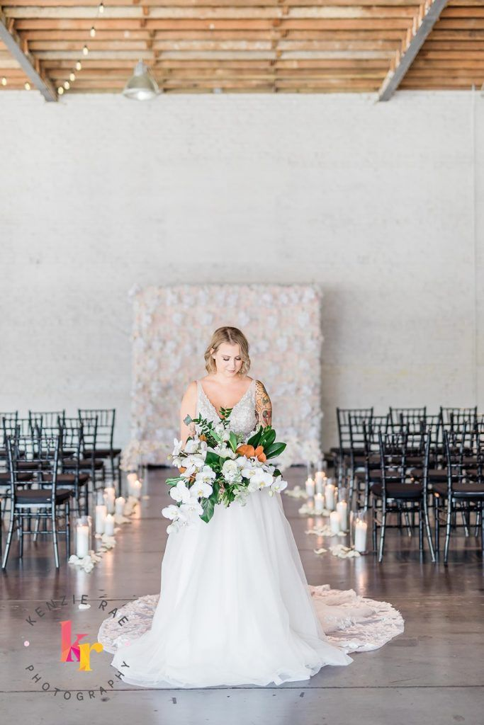 ceremony set up with bride in front of flower wall
