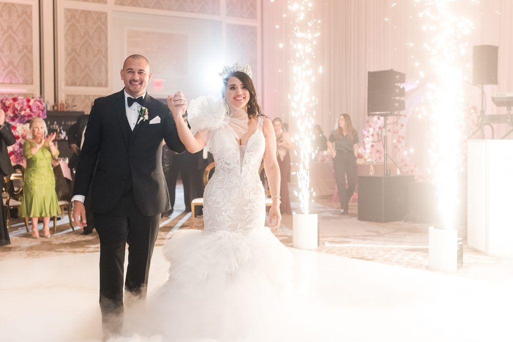 bride and groom with sparkler cannon