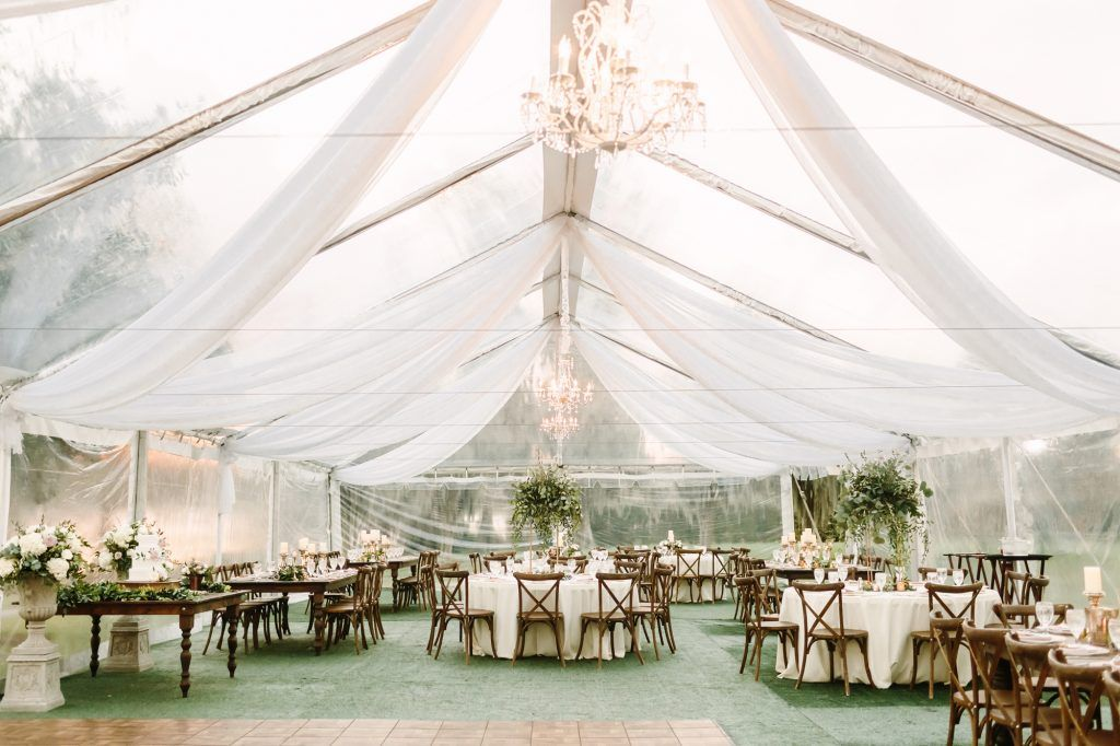 clear tent with hanging chandeliers