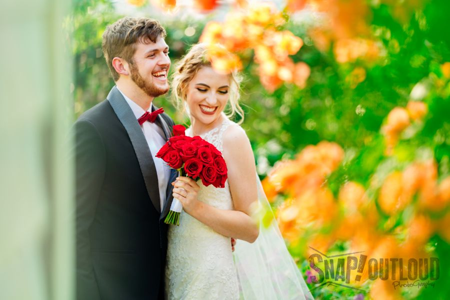 bride and groom with red roses