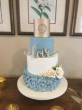 four tired wedding cake with love