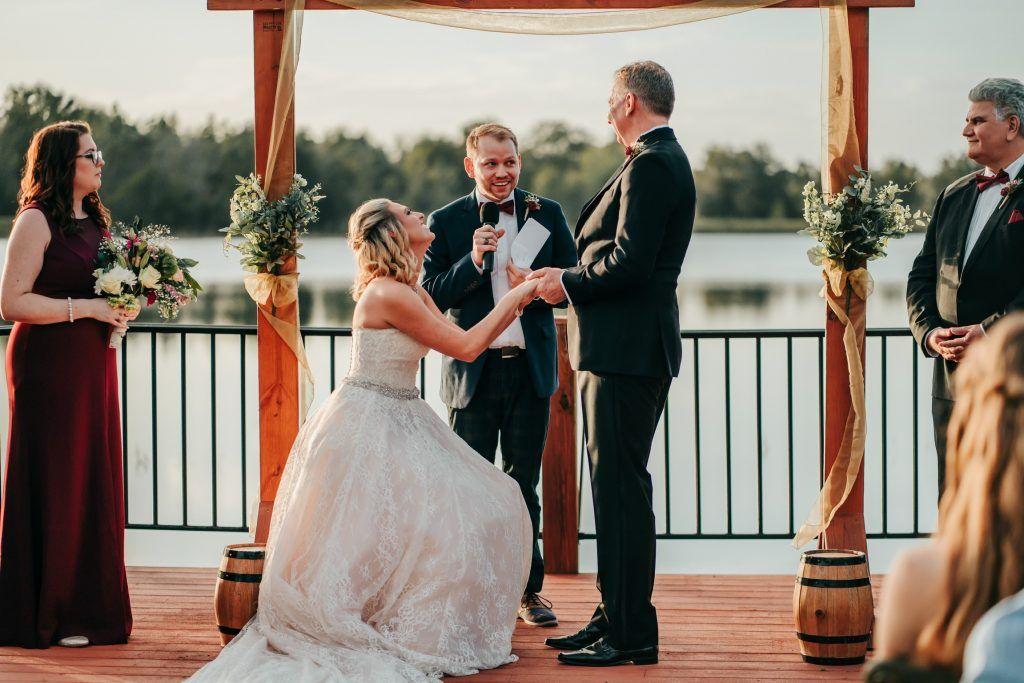 bride kneeling for groom at ceremony