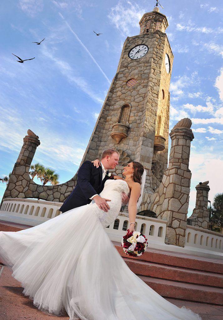 Bride and groom in front of daytona beach clock