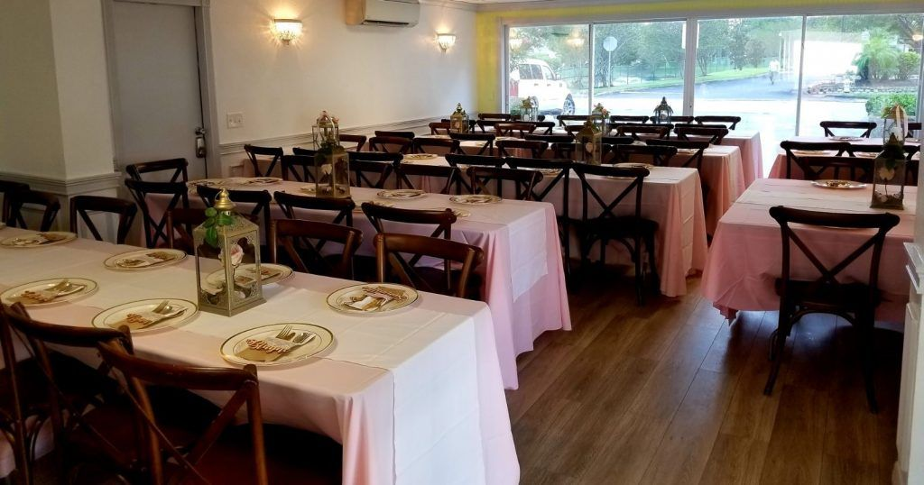 wedding reception with wooden chairs
