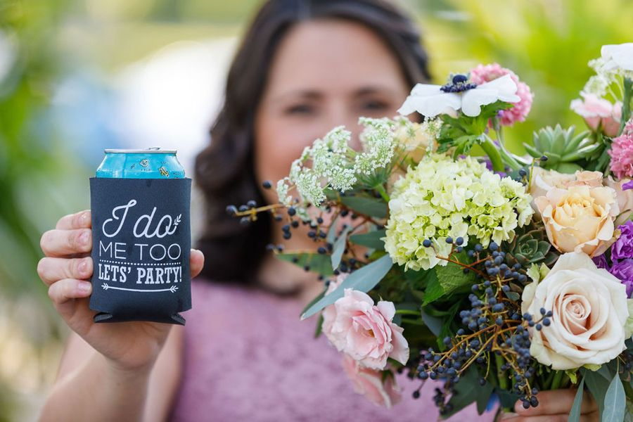 bridesmaid with floral and customized drink holderr