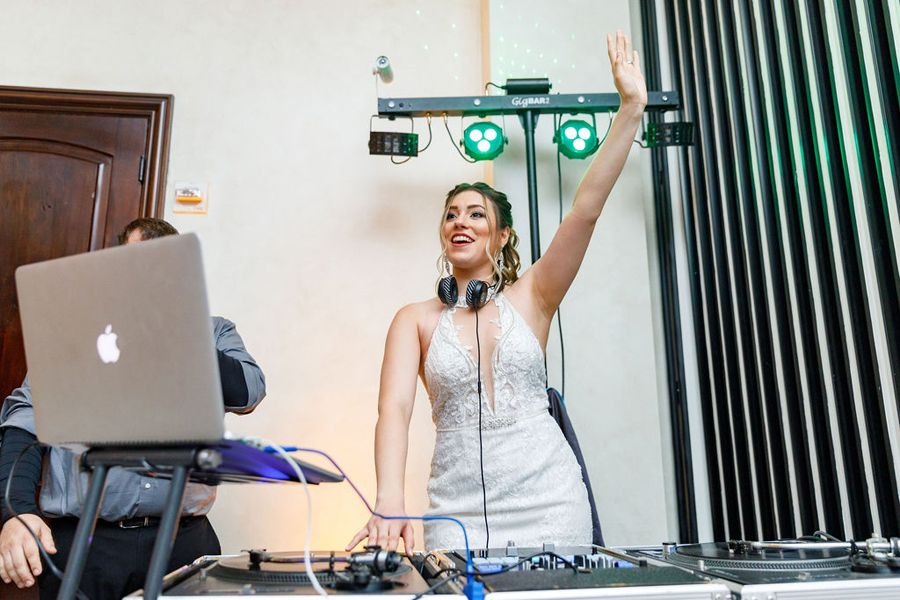 your expert storytellers bride playing DJ