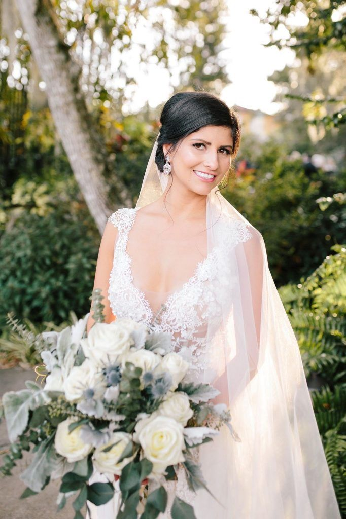 bride with veil and floral