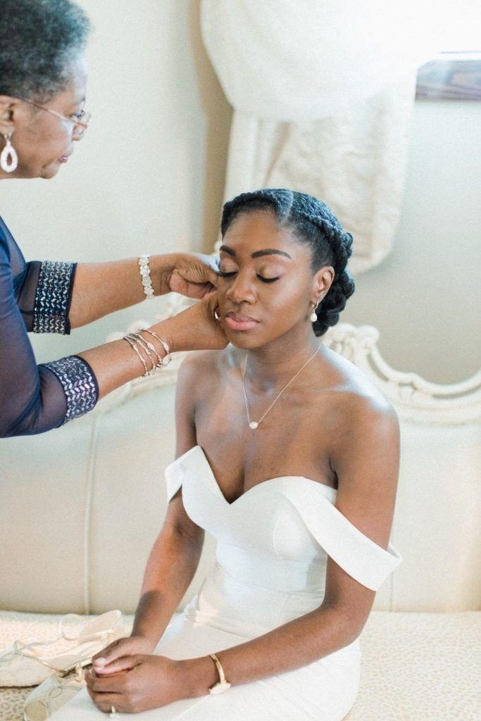 MOH putting earring on bride