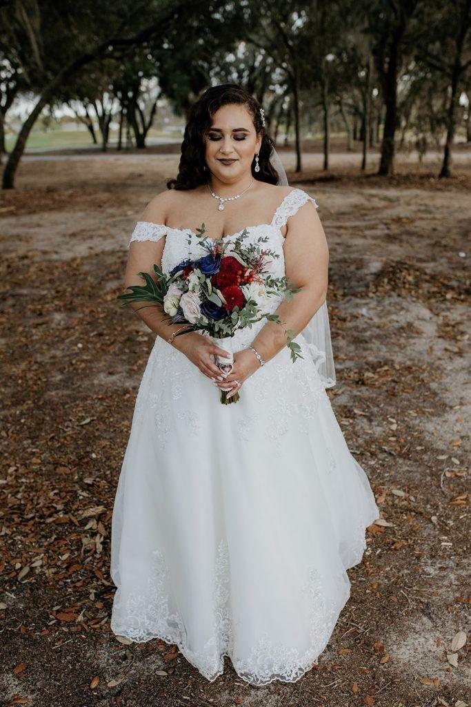bride outside holding floral