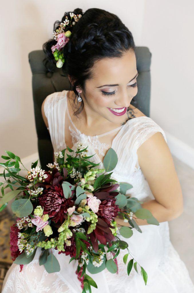 bride looking over shoulder holding bouquet