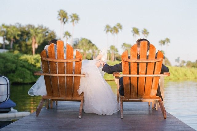 bride and groom relaxing in Adirondack chairs