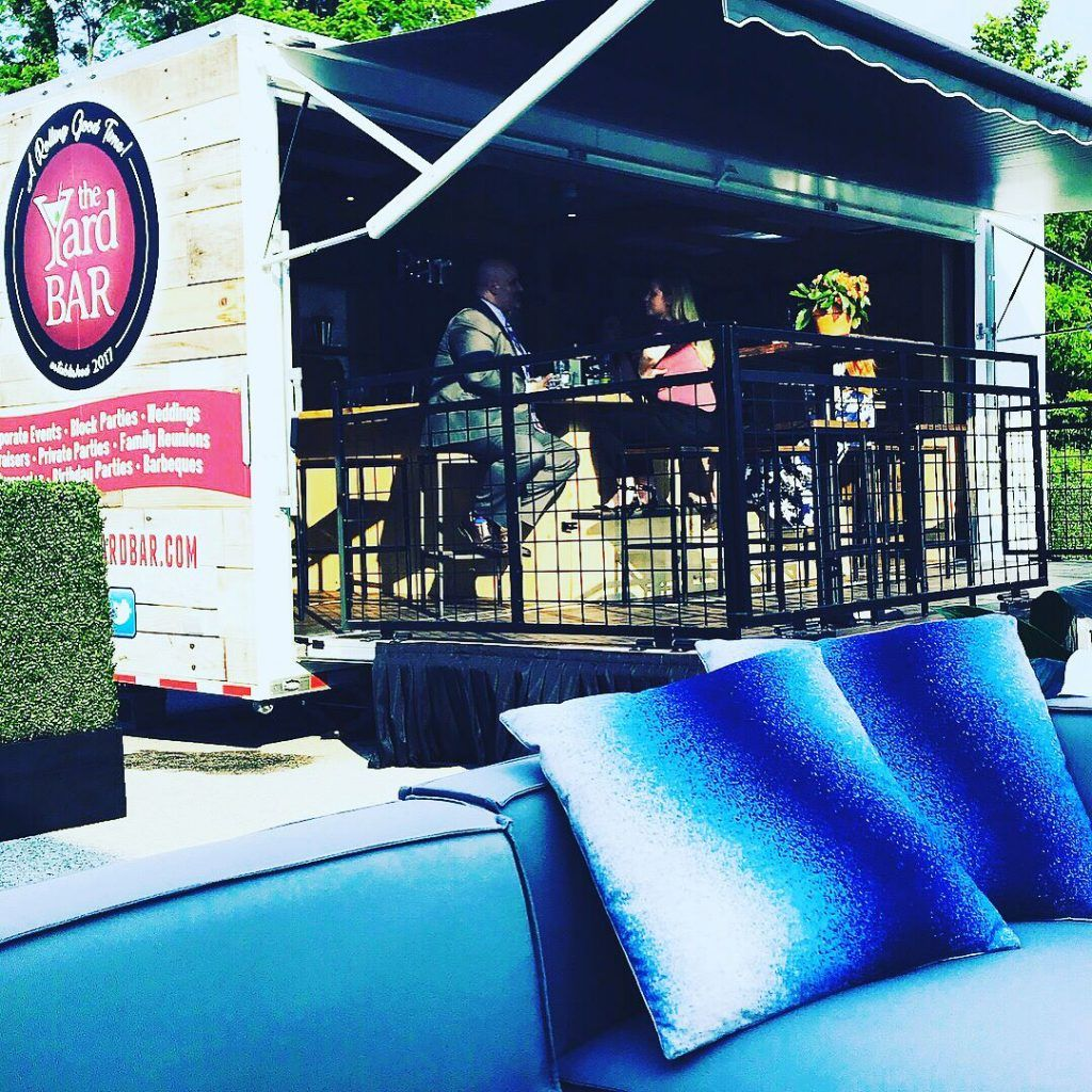 pillows in front of mobile yard bar