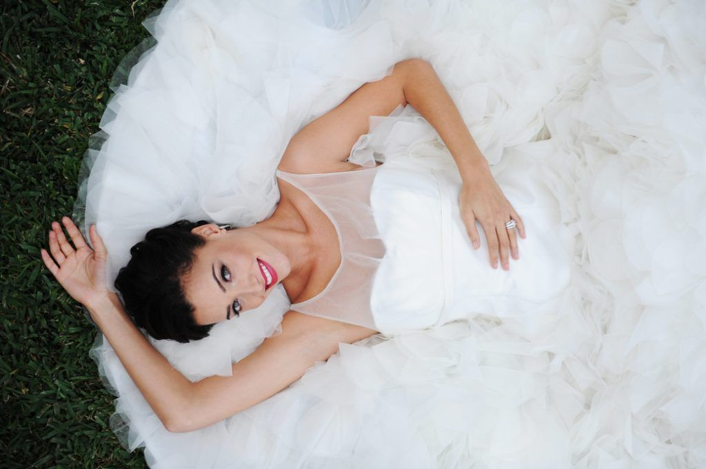 bride laying on her dress