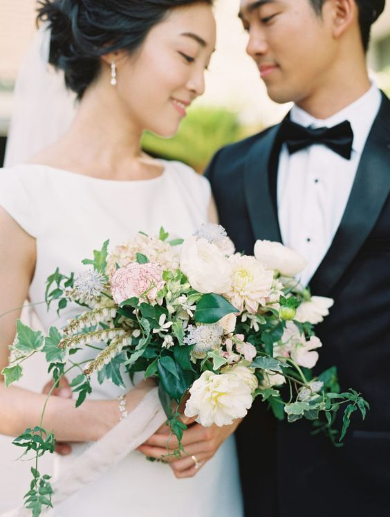 bride and groom with floral bouquet