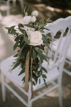 white rose on ceremony chair