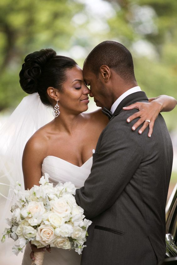 bride and groom with light colored floral