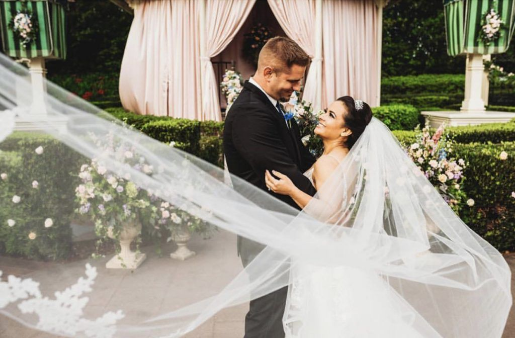 bride and groom with floating veil