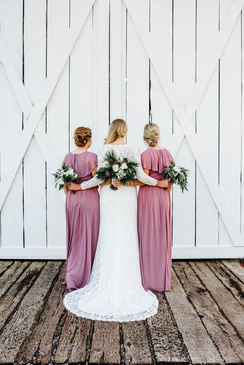 bride with bridesmaids and floral