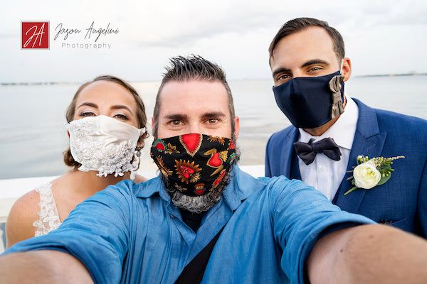 couple in masks with photographer