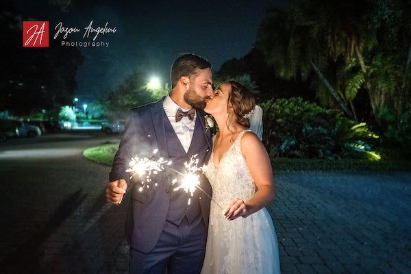 couple sharing a kiss with sparklers
