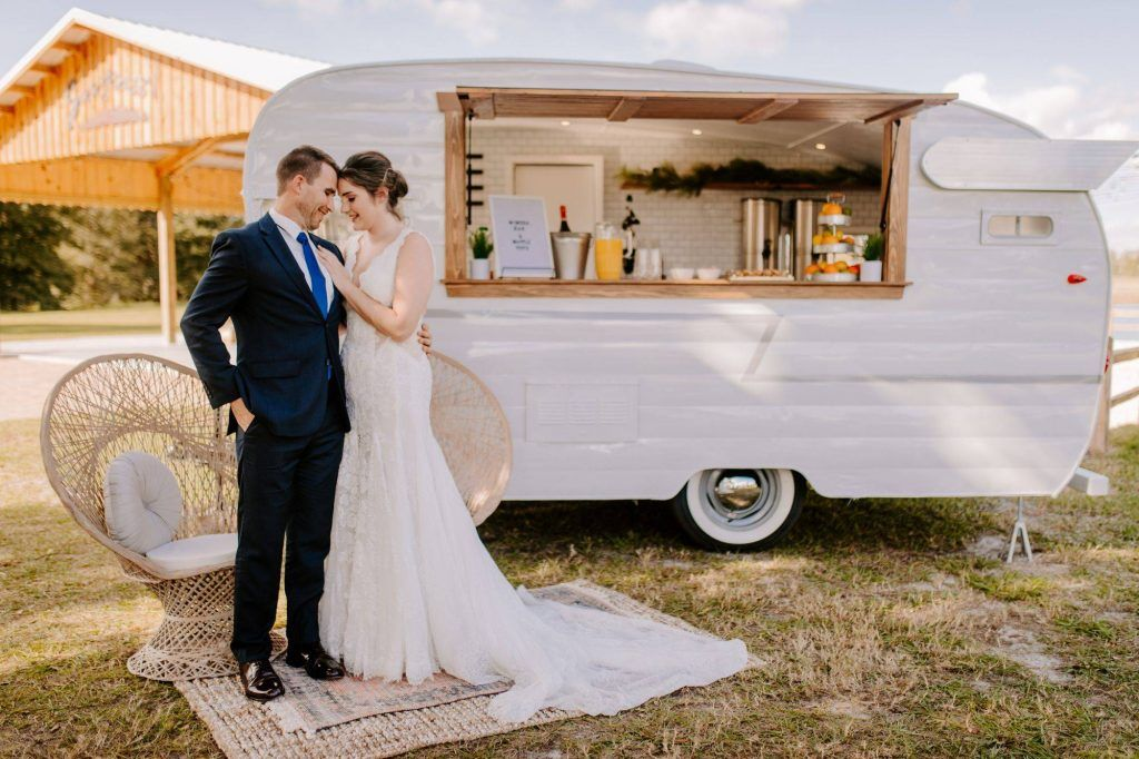 bride and groom with drink caravan