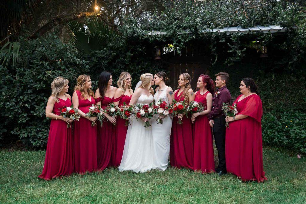 bride and bride with wedding party