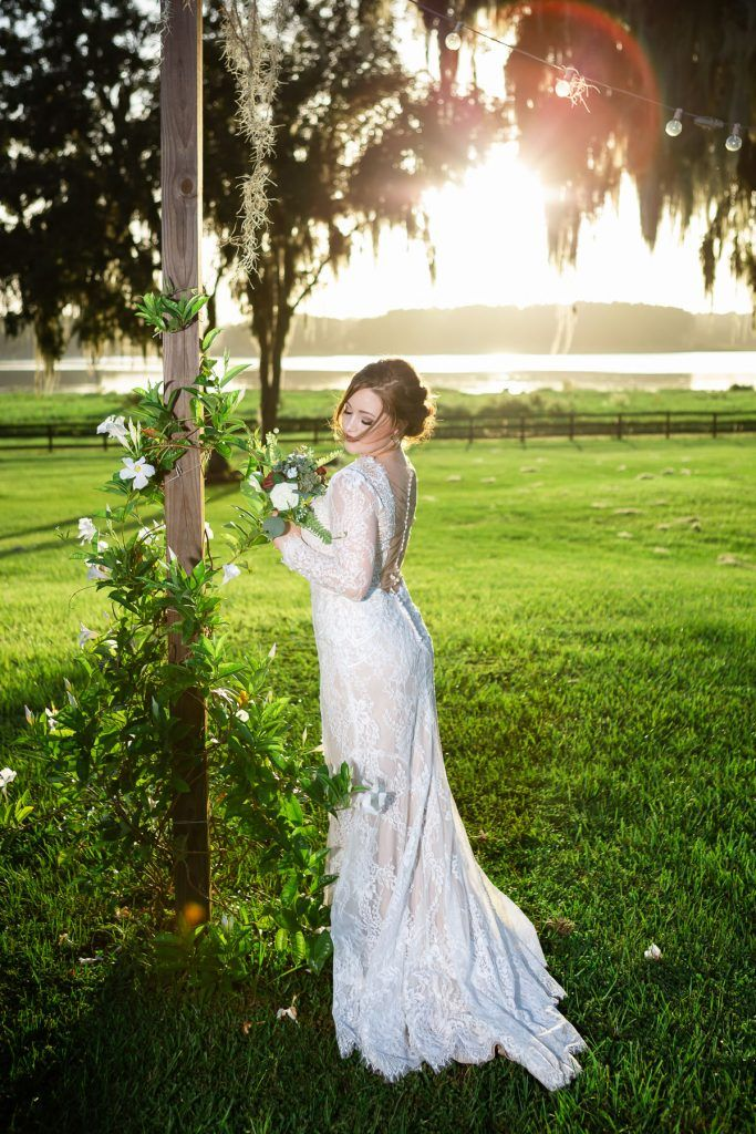 bride with floral and tree