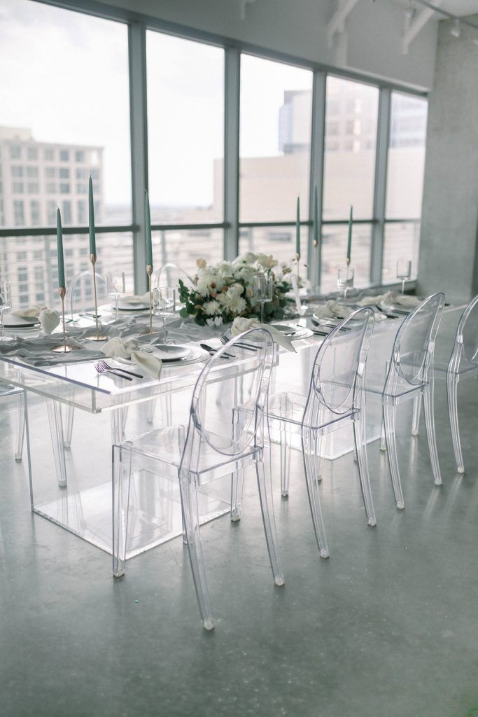 clear chairs and table