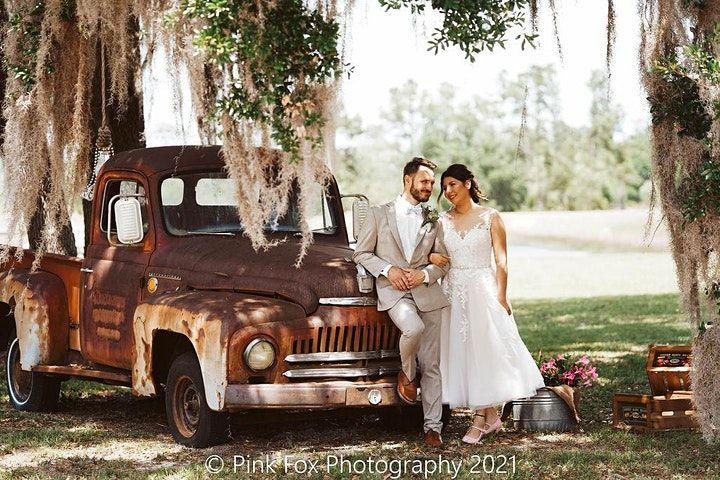 bride and groom in front of truck