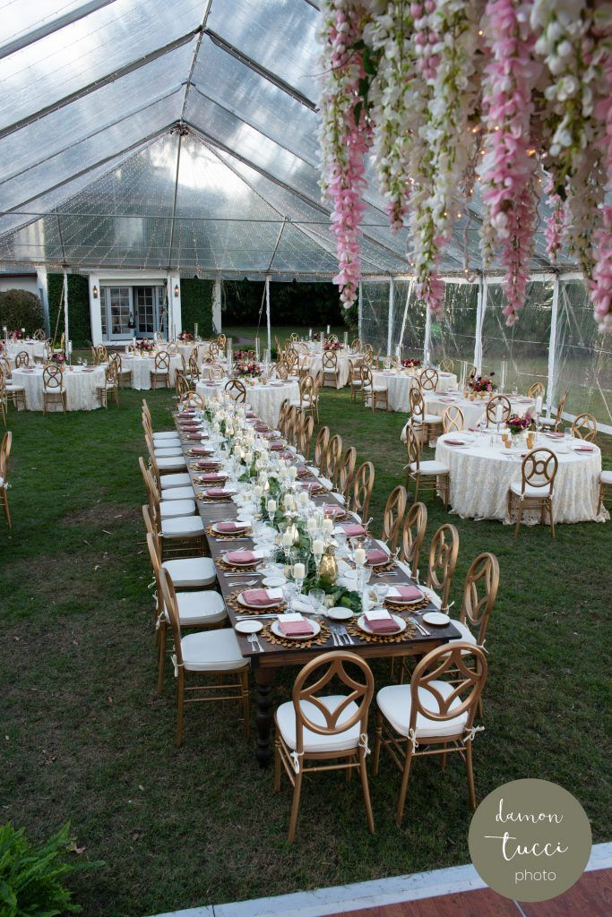 outside wedding reception under clear tent