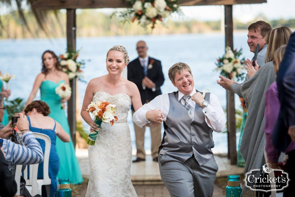 recently married couples dances down the aisle