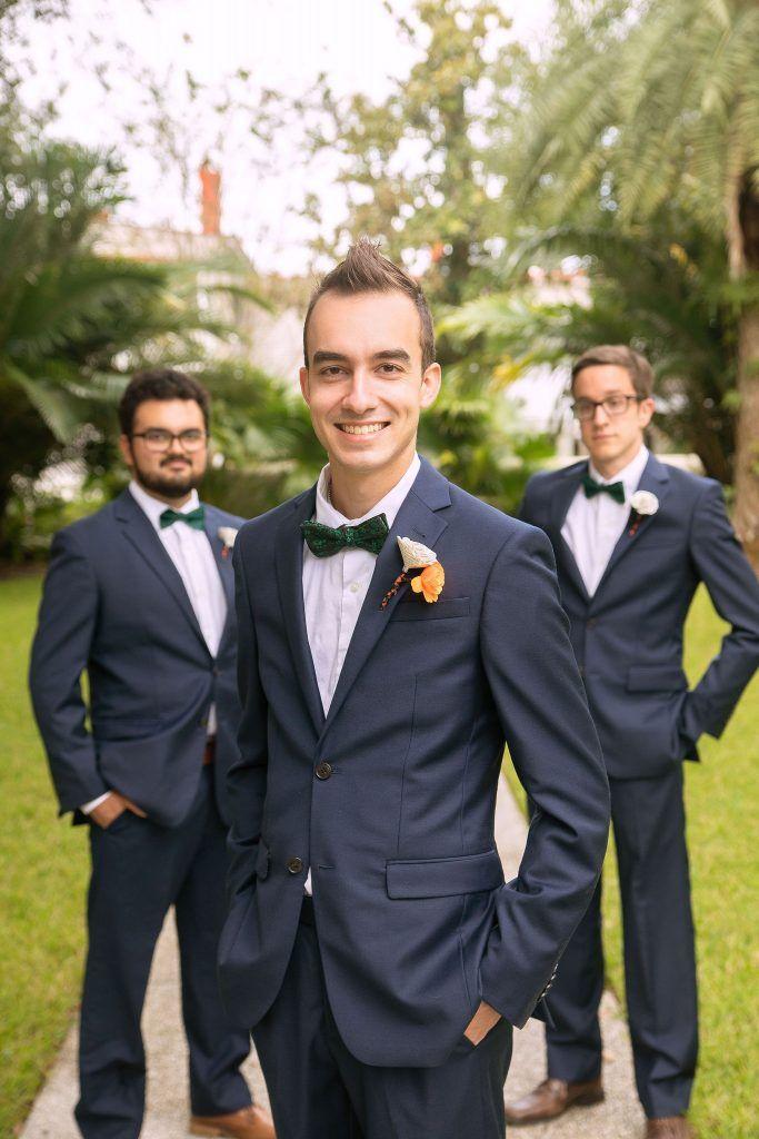 groom and groomsmen wearing navy suits