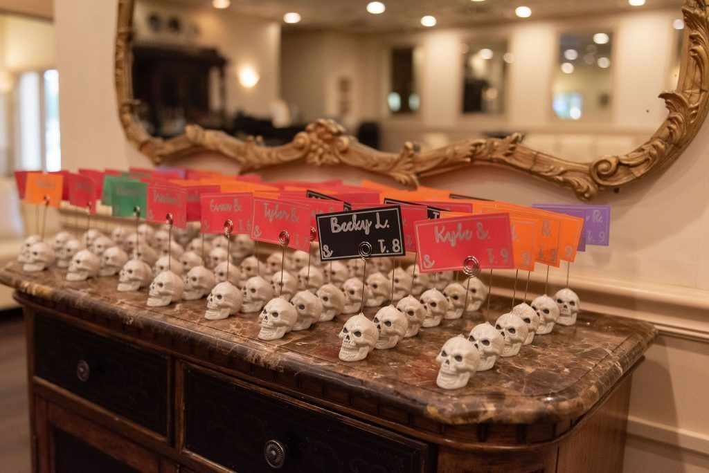 skull place card holders for halloween wedding