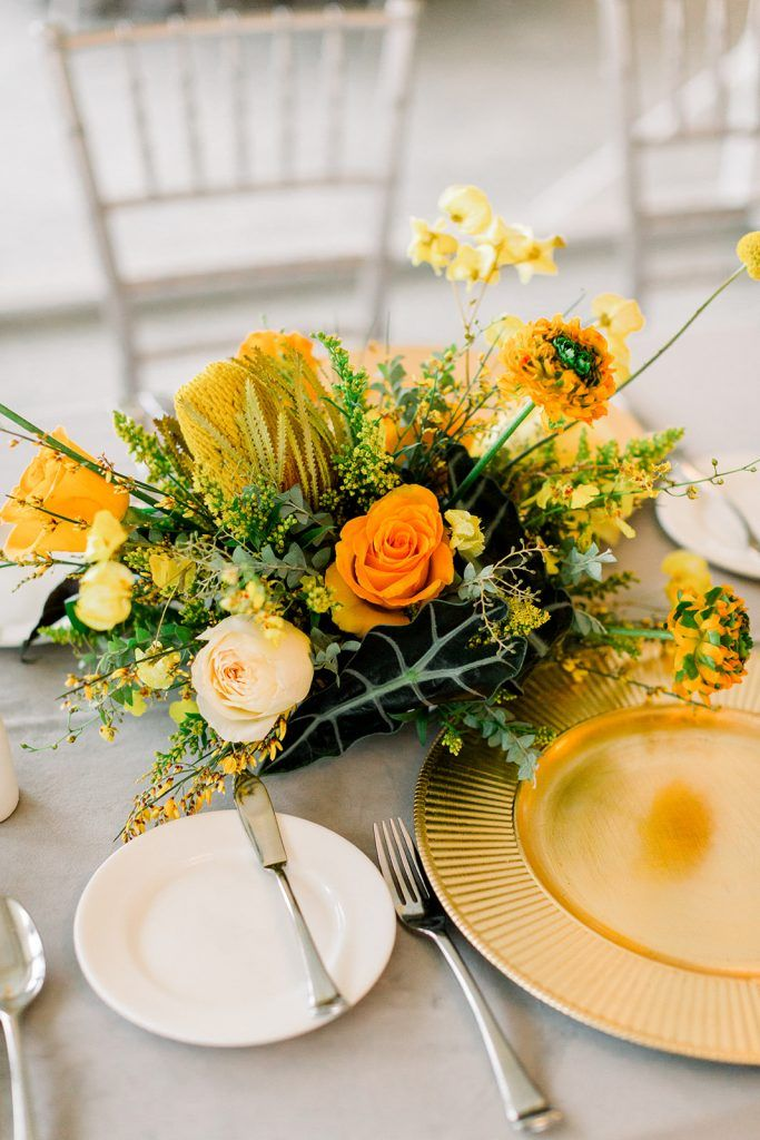 gold charger with illuminating floral centerpiece