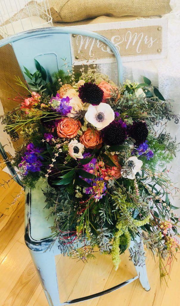 wedding bouquet peach, black, white, green, puprle