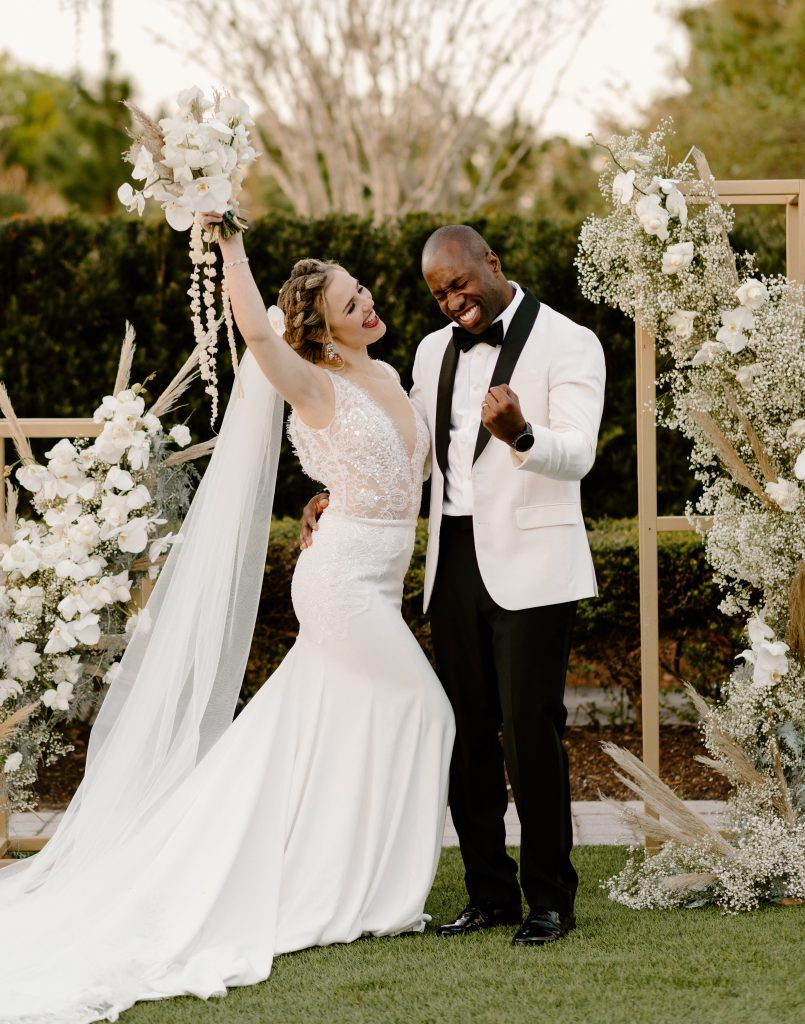 interracial bride and groom excited