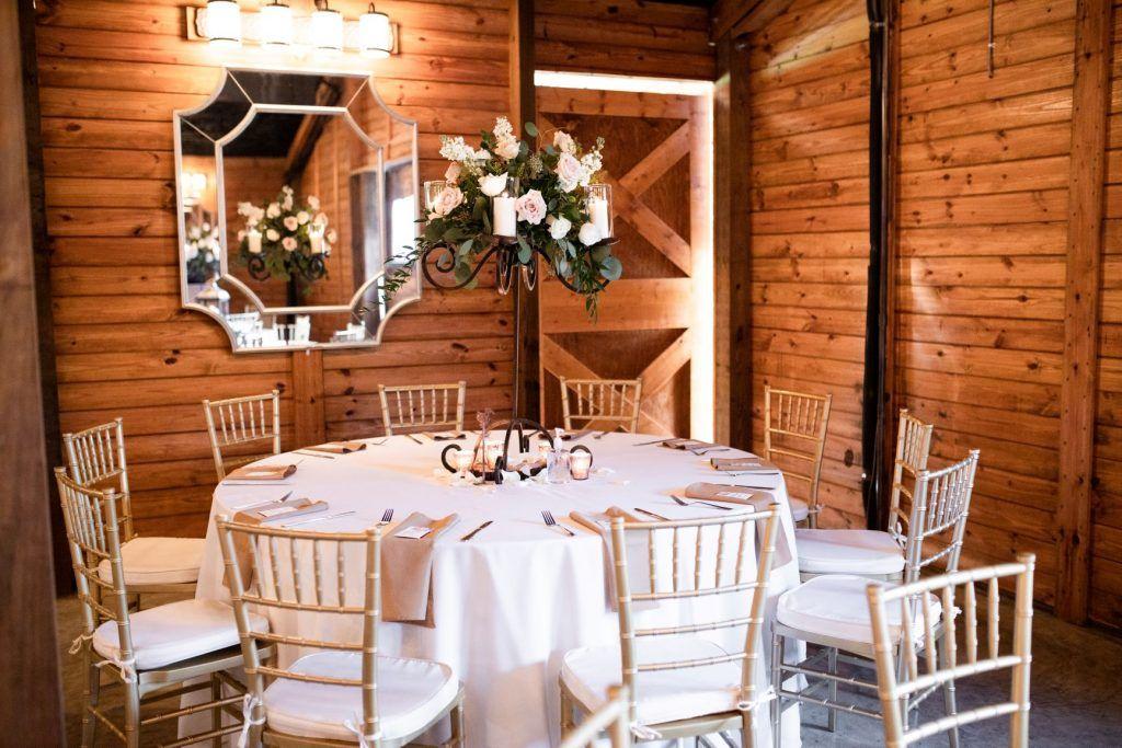 Reception venue table setting for barn wedding