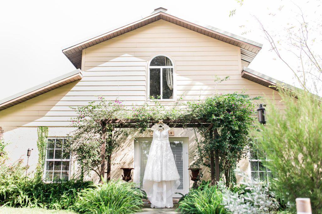 wedding dress hanging outside BLB Hacienda barn wedding venue
