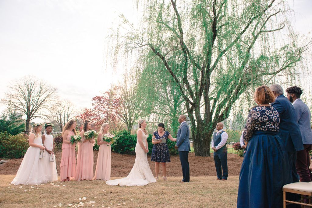 outside wedding ceremony in front of tree