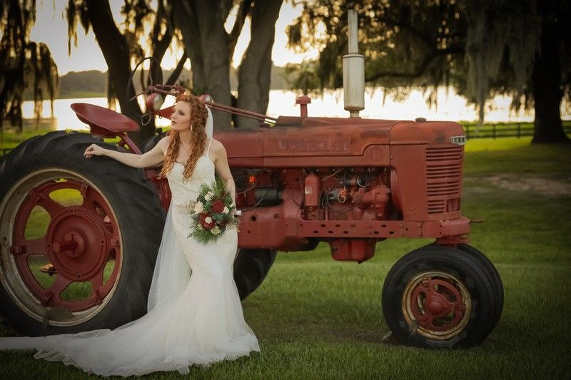 bride with bouquet in front of tractor