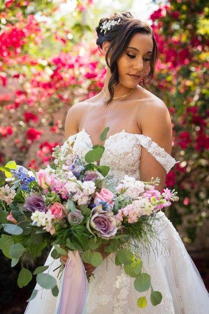 bride with large floral bouquet